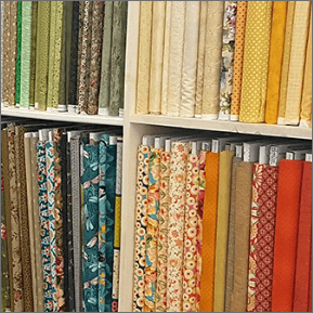 Wall of patchwork fabrics